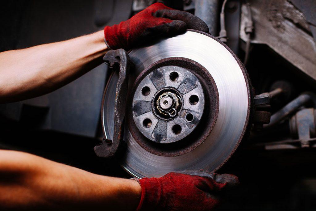 Mechanic repairing a car brake system